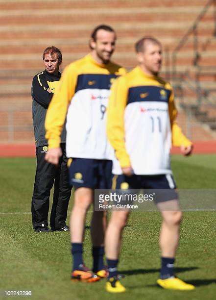 Australian coach Pim Verbeek looks on as Josh Kennedy and Scott Chipperfield warm up during an Australian Socceroos training session at Ruimsig...