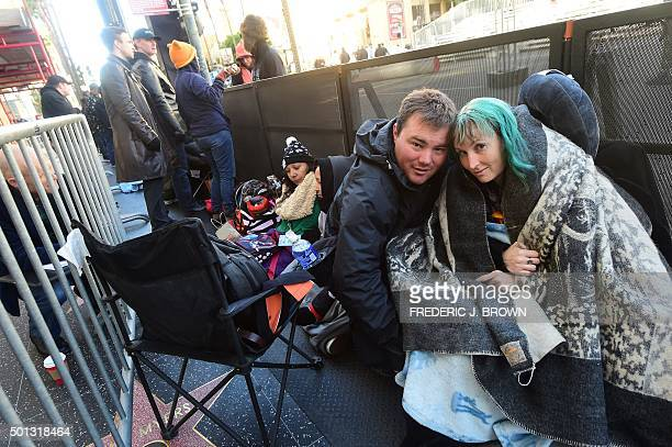 Australian couple Caroline Ritter and Andrew Porters hold their spot in a line of hardcore Star Wars fans who have been camped out following a cold...