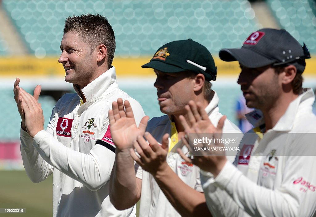 Australian cricket captain Michael Clarke (L) applauds during the presentation ceremony after defeating Sri Lanka on the fourth day of the third cricket Test match between Australia and Sri Lanka at the Sydney Cricket Ground on January 6, 2013. Australia beat Sri Lanka in the three Test series 3-0.