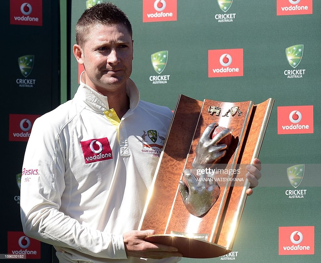 Australian cricket captain Michael Clarke poses with the trophy after defeating Sri Lanka on the fourth day of the third cricket Test match between Australia and Sri Lanka at the Sydney Cricket Ground on January 6, 2013. Australia beat Sri Lanka in the three Test series 3-0. AFP PHOTO/ MANAN VATSYAYANA USE