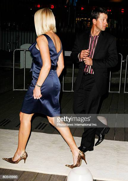 IMAGE Australian cricket captain Ricky Pointing and his wife Rianna arrive at the engagement party for Lara Bingle and her cricketer boyfriend...