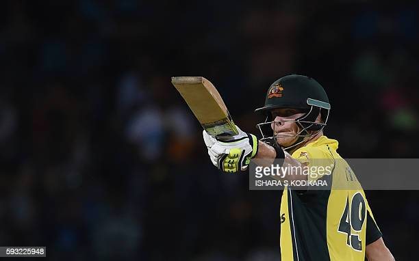 Australian cricket captain Steven Smith celebrates 50 runs during the first One Day International cricket match between Sri Lanka and Australia at...