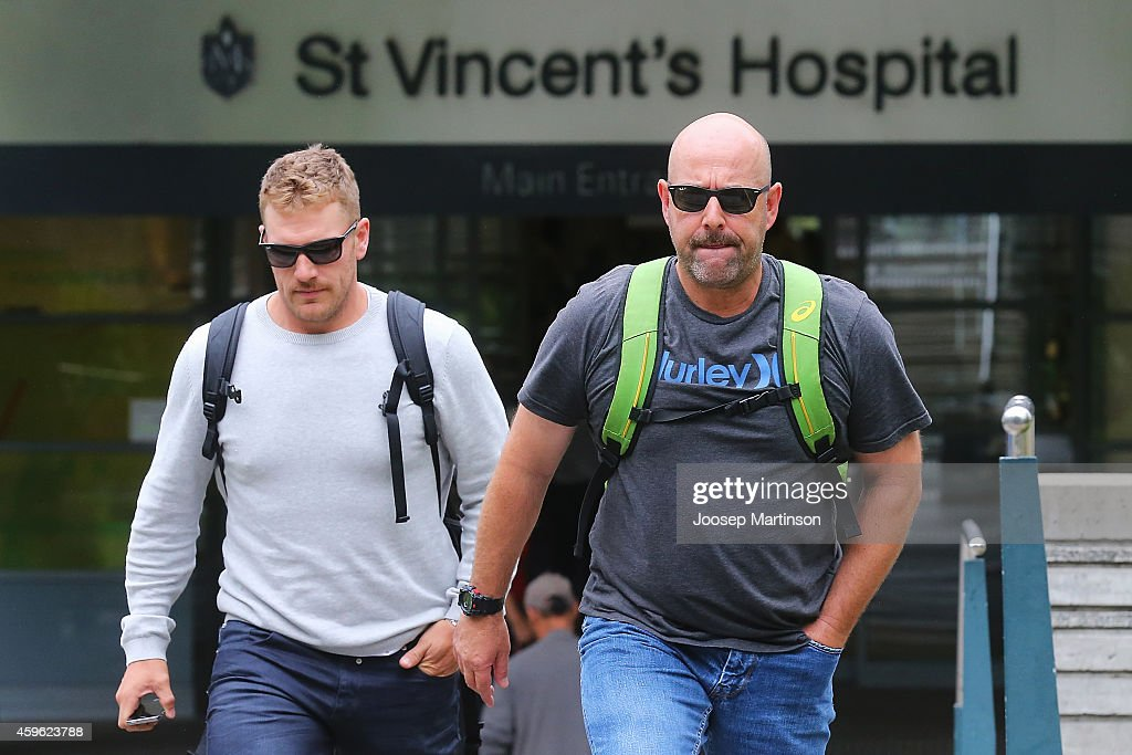 Australian cricket coach <a gi-track='captionPersonalityLinkClicked' href=/galleries/search?phrase=Darren+Lehmann+-+Cricket+Player&family=editorial&specificpeople=171311 ng-click='$event.stopPropagation()'>Darren Lehmann</a> (R) and <a gi-track='captionPersonalityLinkClicked' href=/galleries/search?phrase=Aaron+Finch+-+Cricket+Player&family=editorial&specificpeople=724040 ng-click='$event.stopPropagation()'>Aaron Finch</a> leave St Vincent's Hospital on November 27, 2014 in Sydney, Australia. South Australian cricket player Phil Hughes was struck by a bouncer delivery during the Sheffield Shield match between New South Wales and South Australia at the SCG on Monday. He was taken to St Vincent's Hospital in a critical condition.
