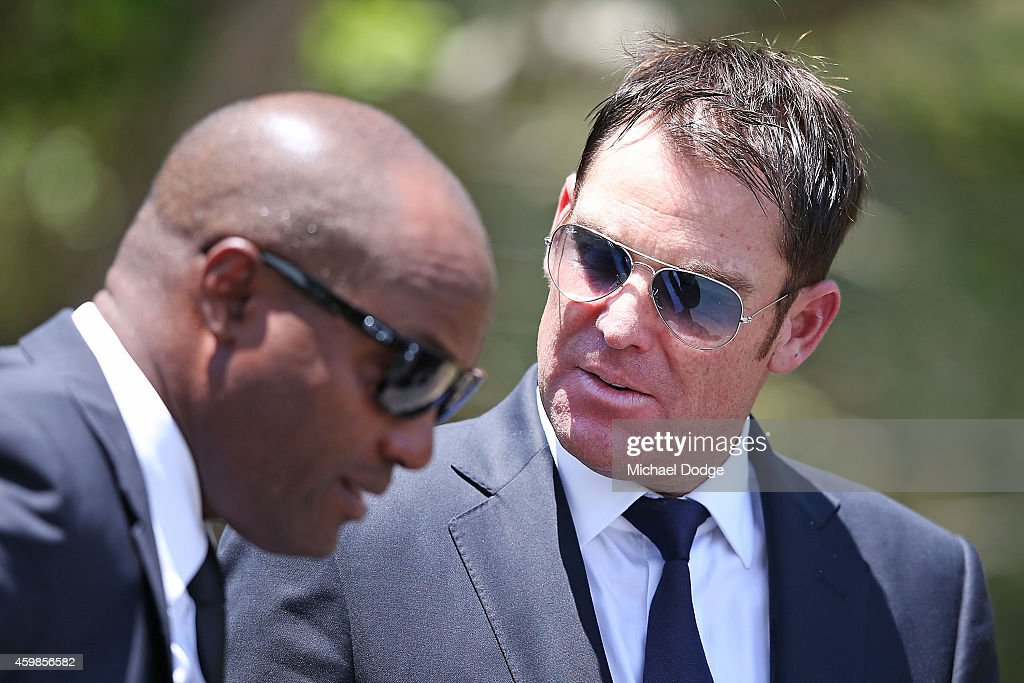 Australian cricket legend Shane (R) Warne and West Indies cricket legend Brian Lara arrive during the Funeral Service for Phillip Hughes on December 3, 2014 in Macksville, Australia. Australian cricketer Phillip Hughes passed away last Thursday, aged 25, as a result of head injuries sustained during the Sheffield Shield match between South Australia and New South Wales at the SCG on Tuesday 25th November.