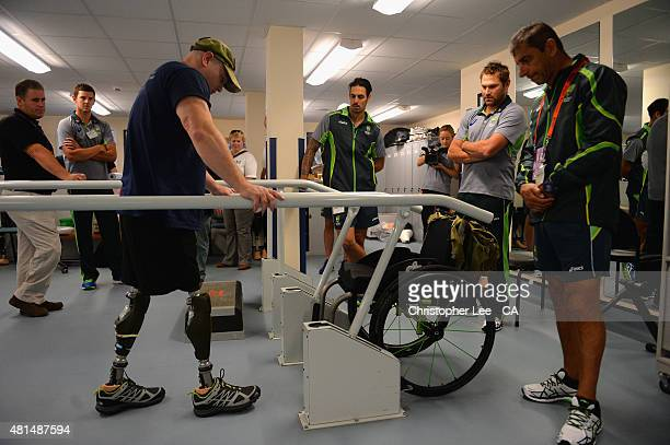 Australian cricket player's Josh Hazelwood Mitchel Johnson and Ryan Harris talk to James Wilson as they visit Headley Court Military Rehabilitative...