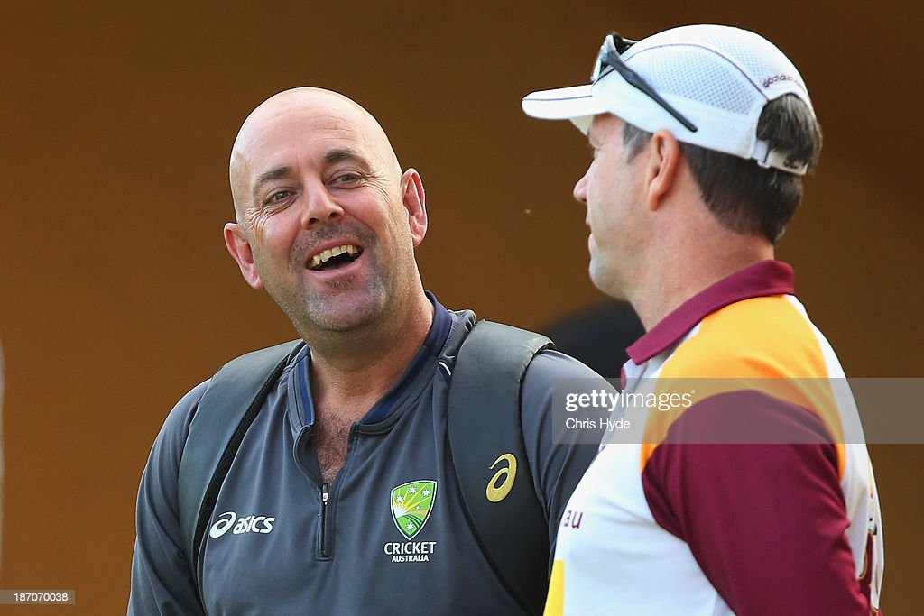 Australian cricket team coach <a gi-track='captionPersonalityLinkClicked' href=/galleries/search?phrase=Darren+Lehmann+-+Cricket+Player&family=editorial&specificpeople=171311 ng-click='$event.stopPropagation()'>Darren Lehmann</a> and Bulls coach <a gi-track='captionPersonalityLinkClicked' href=/galleries/search?phrase=Stuart+Law&family=editorial&specificpeople=214610 ng-click='$event.stopPropagation()'>Stuart Law</a> talk during day one of the Sheffield Shield match between the Queensland Bulls and the Tasmania Tigers at Allan Border Field on November 6, 2013 in Brisbane, Australia.