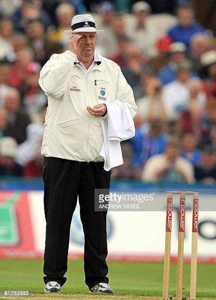 Australian cricket umpire Darrell Hair adjusts his glasses as he umpires on the first day of the second Test match between England and New Zealand at...