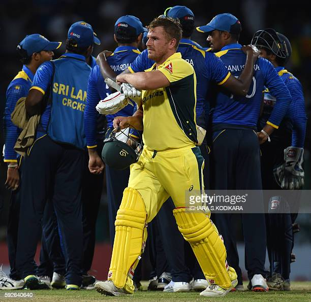 Australian cricketer Aaron Finch leaves the ground after being dismissed by Sri Lanka's Amila Aponso during the first One Day International cricket...