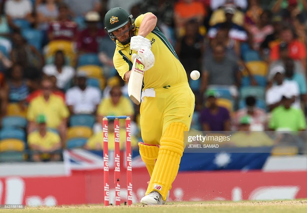 Australian cricketer Aaron Finch plays a shot during the final match of the Tri-nation Series between Australia and West Indies in Bridgetown on June 26, 2016. / AFP / Jewel SAMAD