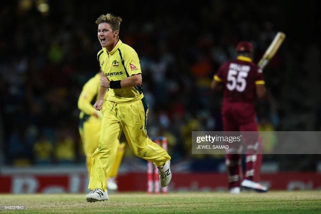 Australian cricketer Adam Zampa (L) celebrates dismissing West Indies batsman Kieron Pollard (#55) during the final match of the Tri-nation Series between Australia and West Indies in Bridgetown on June 26, 2016. / AFP / Jewel SAMAD