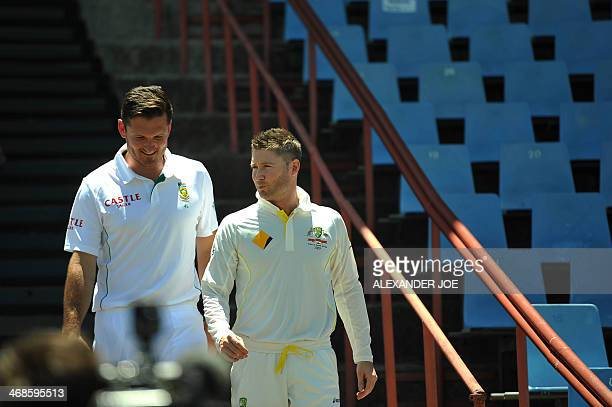 Australian cricketer and Austalian team's captain Michael Clarke and South African cricketer and team's captain Graeme Smith chat as they walk to the...
