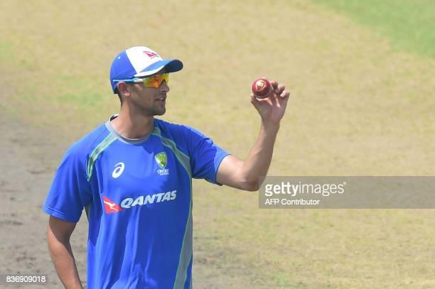 Australian cricketer Ashton Agar attends a training session at the ShereBangla National Cricket Stadium in Dhaka on August 22 2017 Australia has...