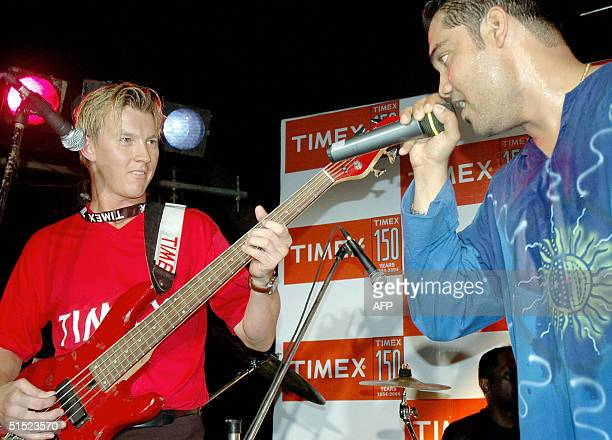 Australian cricketer Brett Lee plays guitar along with the Indian band Aqua Flow during a special show 'Rock with Brett' as a Timex promotion in the...