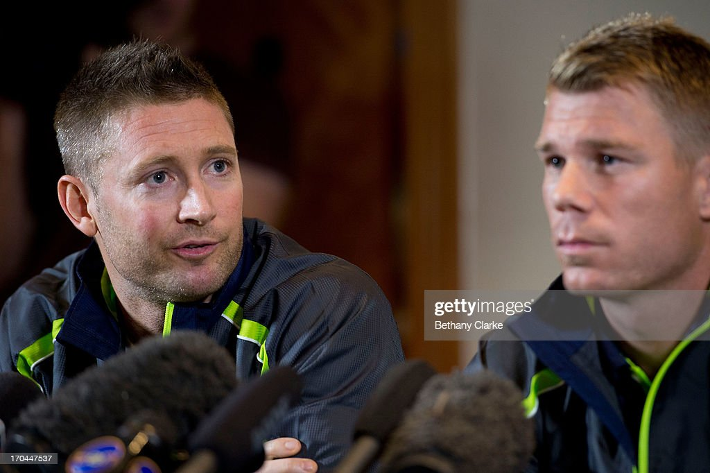 Australian cricketer David Warner and Captain Michael Clarke talk to the press at Royal Garden Hotel on June 13, 2013 in London, England. David Warner and Captain Michael Clarke hold a press conference after David Warner was suspended for an alleged attack on England's Joe Root.