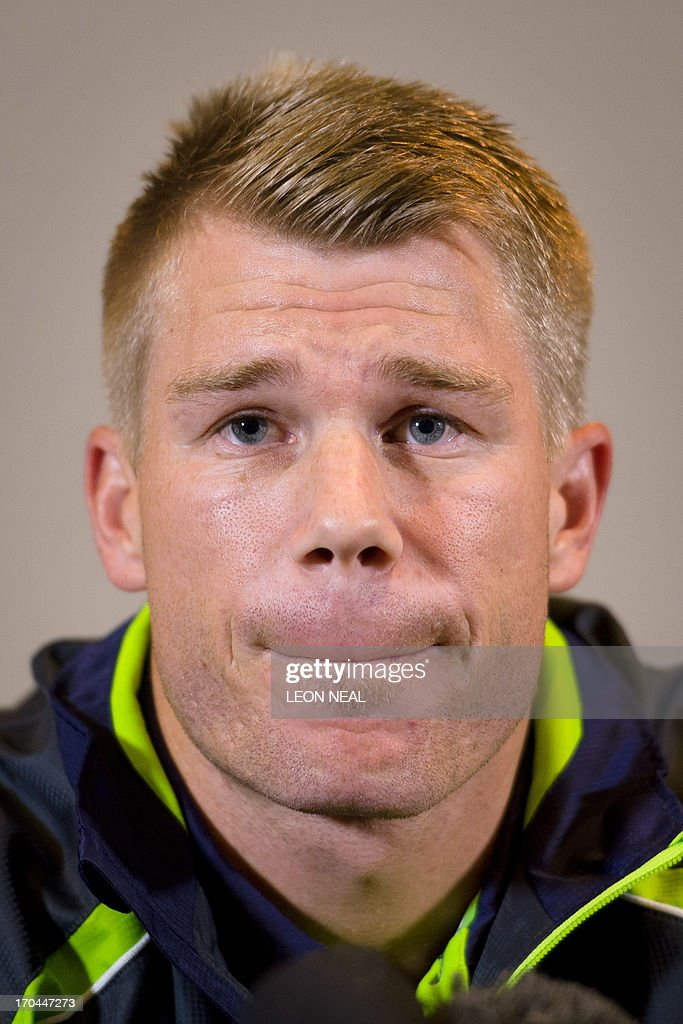Australian cricketer David Warner answers questions from the media during a press conference in central London, on June 13, 2013. Australia batsman David Warner on Thursday apologised to Joe Root after punching the England batsman in a Birmingham bar during the ongoing Champions Trophy.