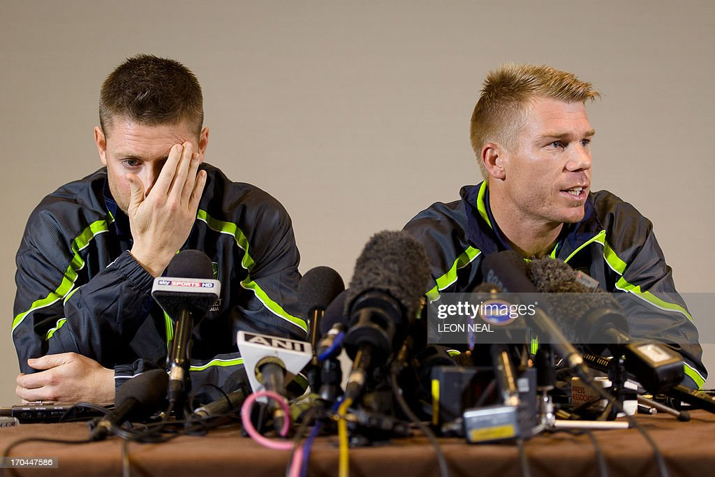 Australian cricketer David Warner (R) answers questions from the media as he sits beside team captain Michael Clarke during a press conference in central London, on June 13, 2013. Australia batsman David Warner on Thursday apologised to Joe Root after punching the England batsman in a Birmingham bar during the ongoing Champions Trophy.