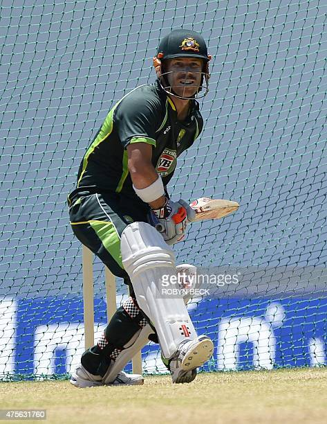 Australian cricketer David Warner attends a training session June 2 2015 at Windsor Park Stadium in Roseau Dominica June 2 ahead of the first Test...