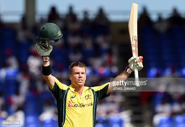 Australian cricketer David Warner celebrates after scoring his century against South Africa during their Trination series One Day International match...