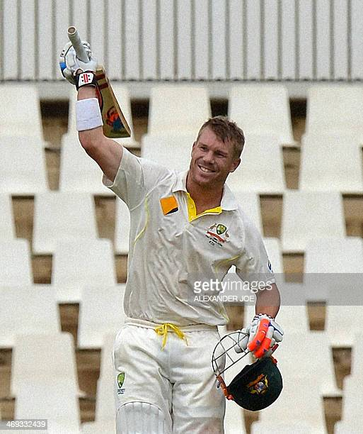 Australian cricketer David Warner celebrates his 100th run during the first test cricket match between South Africa and Australia at SuperSport Park...