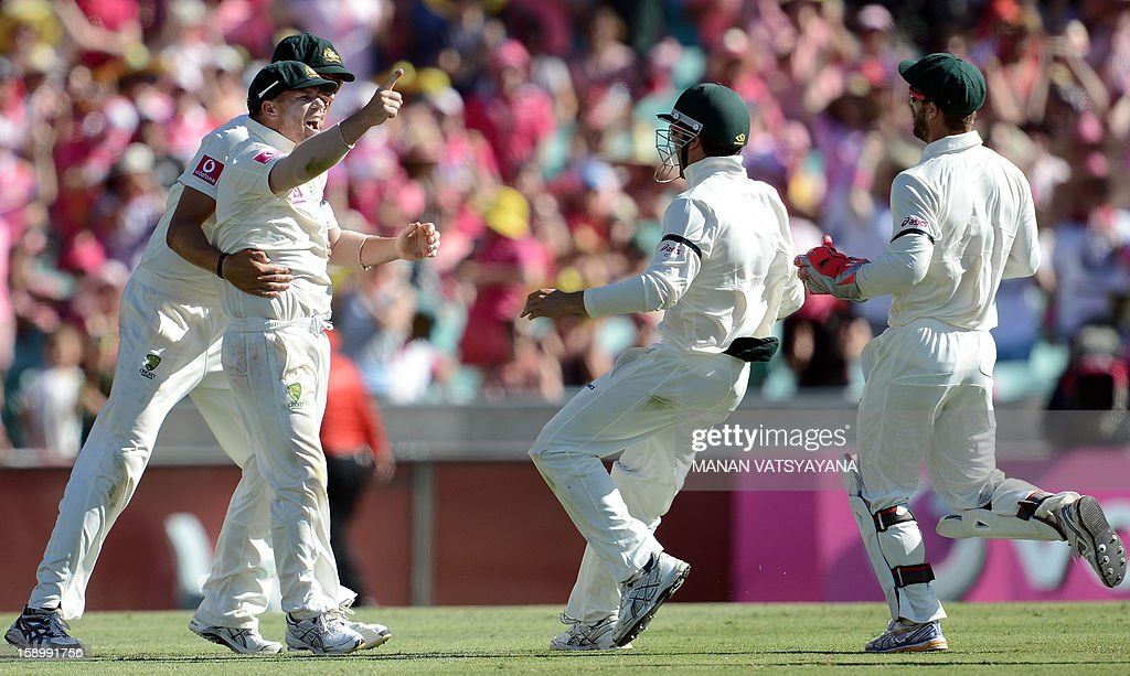 Australian cricketer David Warner (L) celebrates with teammates after running out Sri Lanka's batsman Angelo Mathews on the third day of the Third cricket Test between Australia and Sri Lanka at the Sydney Cricket Ground on January 5, 2013.