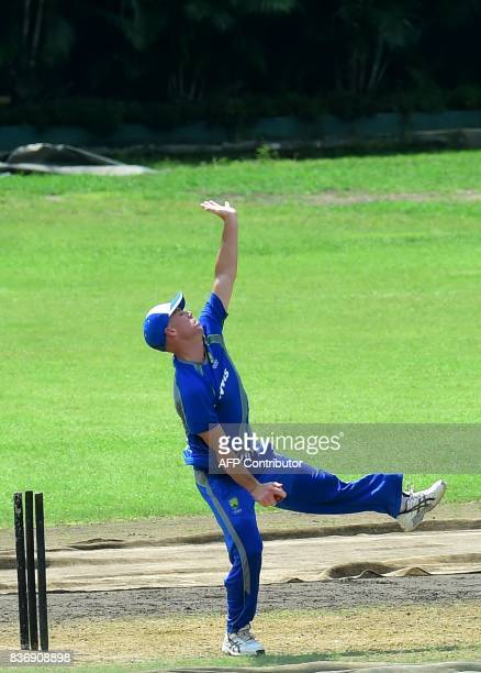 Australian cricketer David Warner delivers a ball during a training session at the ShereBangla National Cricket Stadium in Dhaka on August 22 2017...