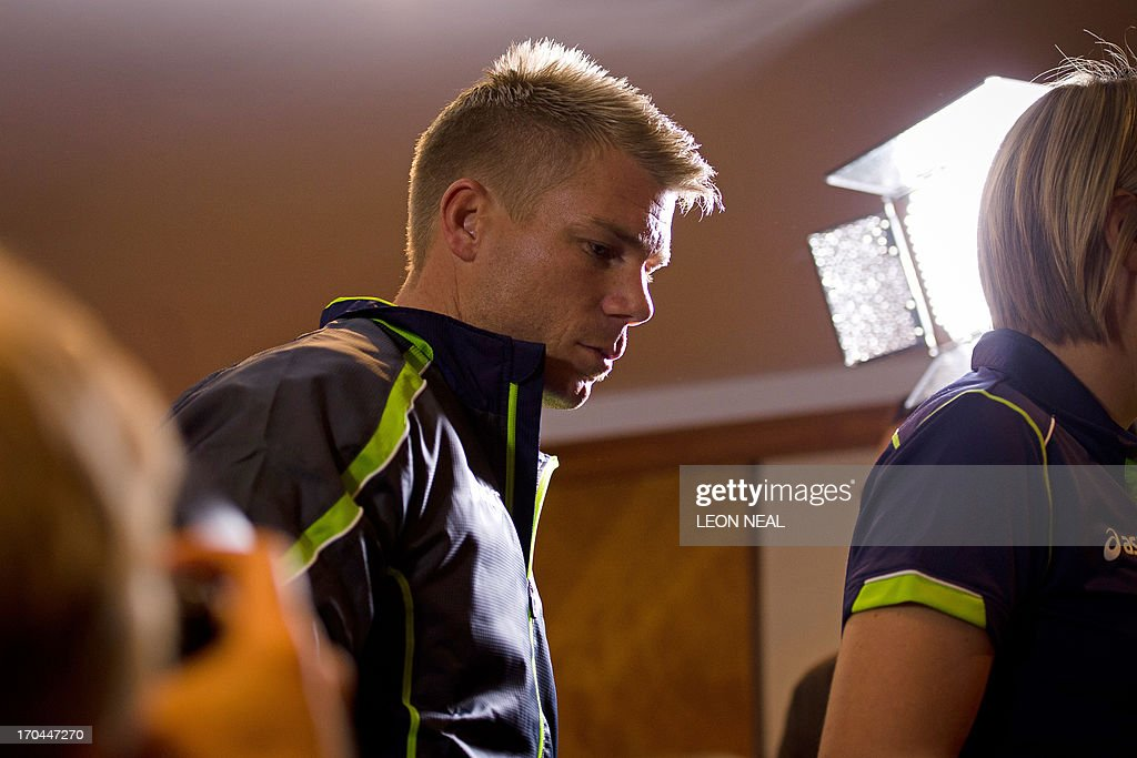 Australian cricketer David Warner leaves the room after answering questions from the media during a press conference in central London, on June 13, 2013. Australia batsman David Warner on Thursday apologised to Joe Root after punching the England batsman in a Birmingham bar during the ongoing Champions Trophy. AFP PHOTO / LEON NEAL