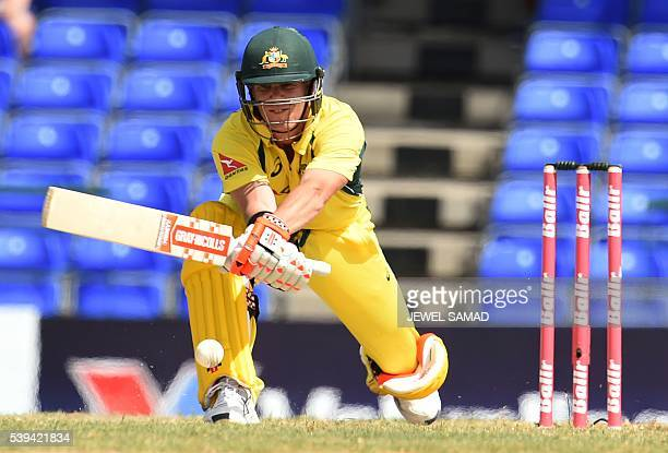 Australian cricketer David Warner plays a shot off South African bowler Aaron Phangiso during their Trination series One Day International match at...