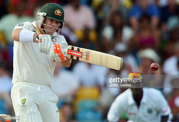Australian cricketer David Warner plays a shot off West Indies bowler Kemar Roach during the second day of the firstofthree Test matches between...