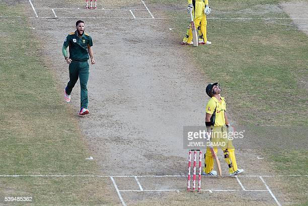 Australian cricketer David Warner reacts after being dismissed by South African bowler Wayne Parnell during their Trination series One Day...