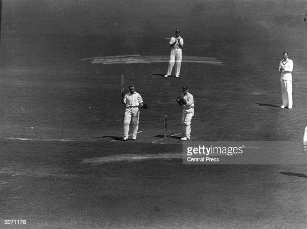 Australian cricketer Don Bradman acknowledges the crowd at the Oval London during his record innings George Duckworth is the wicketkeeper