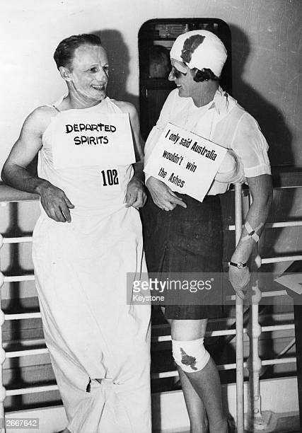 Australian cricketer Don Bradman and a lady friend enjoy a chat during a fancy dress party