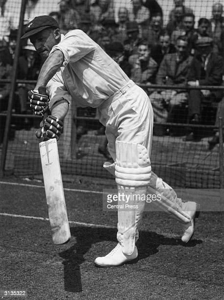 Australian cricketer Don Bradman demonstrates his unrivalled skill as a batsman whilst batting in the nets during a training session In 1949 he...