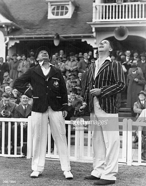Australian cricketer Donald Bradman and the Worcester captain A F T White toss a coin for the start of their threeday match