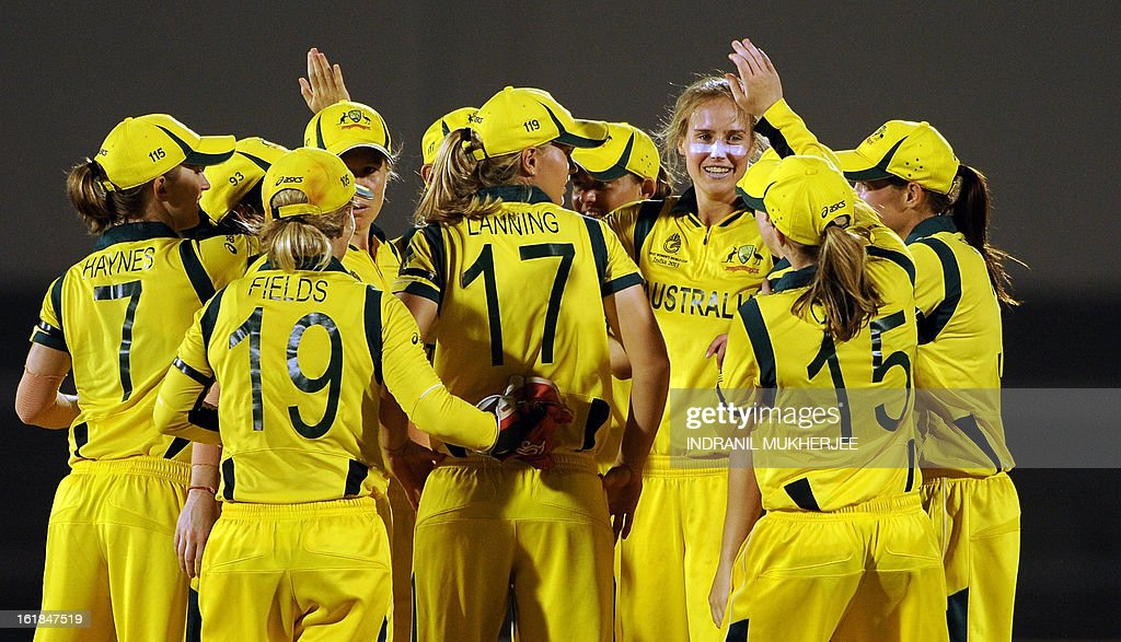 Australian cricketer Elysse Perry (3R) is sorrounded by teammates as they celebrate the wicket of unseen West Indies cricketer Stafanie Taylor during the final match of the ICC Women's World Cup 2013 between Australia and West Indies at the Cricket Club of India's Brabourne stadium in Mumbai on February 17, 2013. AFP PHOTO/Indranil MUKHERJEE