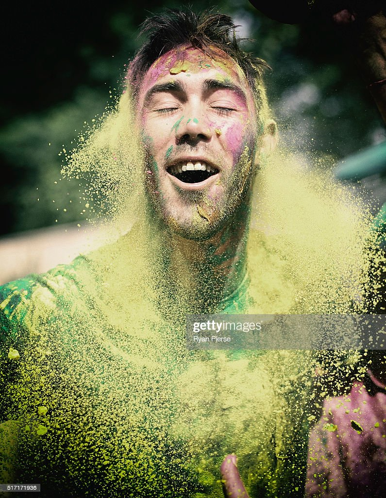 Australian Cricketer <a gi-track='captionPersonalityLinkClicked' href=/galleries/search?phrase=Glenn+Maxwell&family=editorial&specificpeople=752174 ng-click='$event.stopPropagation()'>Glenn Maxwell</a> celebrates Holi Festival of Colours with Chandigargh locals ahead of the ICC WT20 match between Australia and Pakistan on March 24, 2016 in Chandigarh, India.