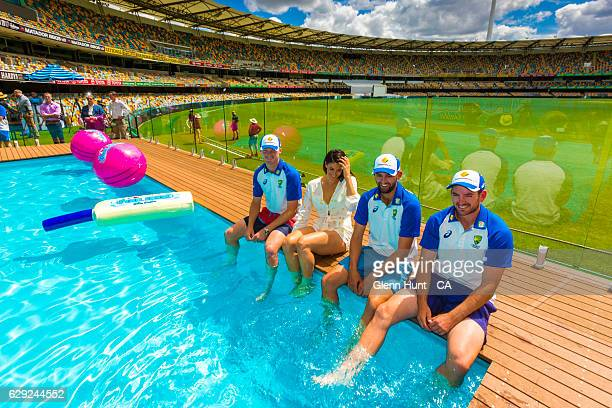 Australian cricketer Jackson Bird former Olympic swimmer and Pool Deck ambassador Stephanie Rice and cricketers Nathan Lyon and Chadd Sayers pose for...