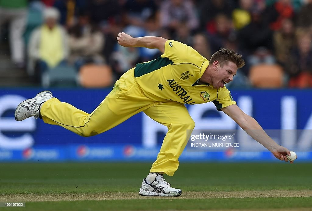 Australian cricketer <a gi-track='captionPersonalityLinkClicked' href=/galleries/search?phrase=James+Faulkner+-+Cricketer&family=editorial&specificpeople=11388189 ng-click='$event.stopPropagation()'>James Faulkner</a> fields a ball off his own bowling at the Bellerive Oval during the 2015 Cricket World Cup Pool A match between Australia and Scotland in Hobart on March 14, 2015. AFP PHOTO / INDRANIL MUKHERJEE USE--