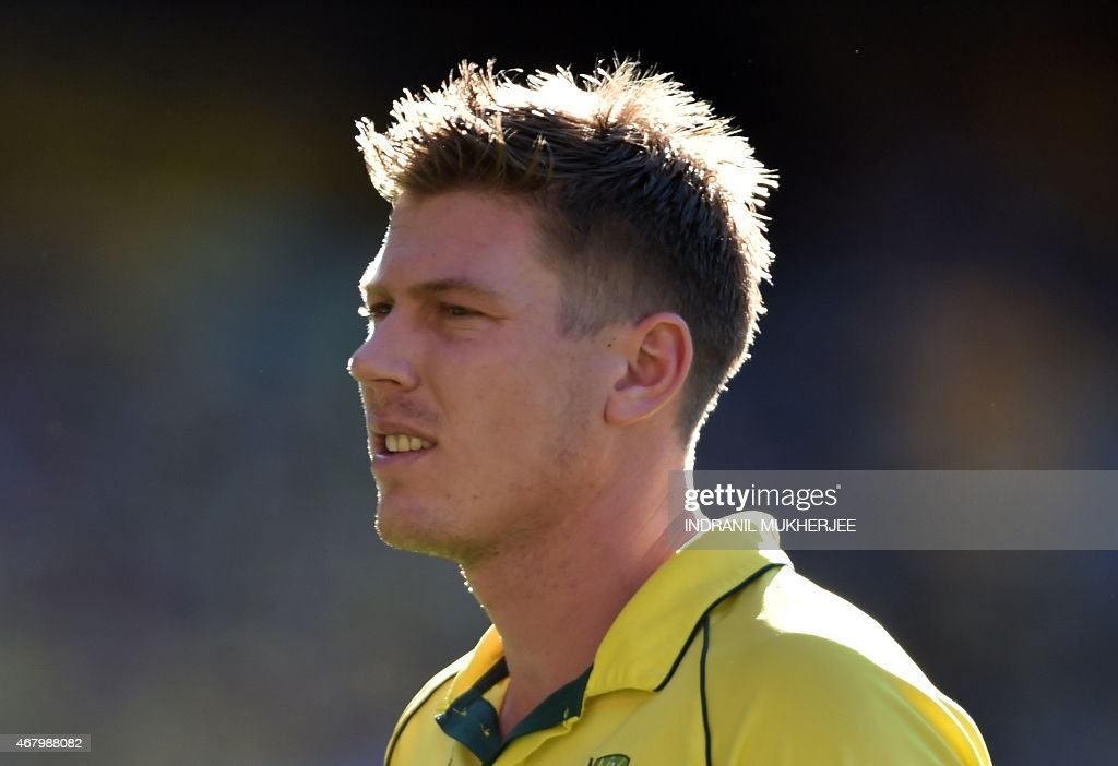 Australian cricketer <a gi-track='captionPersonalityLinkClicked' href=/galleries/search?phrase=James+Faulkner+-+Cricketer&family=editorial&specificpeople=11388189 ng-click='$event.stopPropagation()'>James Faulkner</a> walks back to his run-up during the 2015 Cricket World Cup final between Australia and New Zealand in Melbourne on March 29, 2015. AFP PHOTO / INDRANIL MUKHERJEE -- IMAGE RESTRICTED TO EDITORIAL USE - STRICTLY NO COMMERCIAL USE--