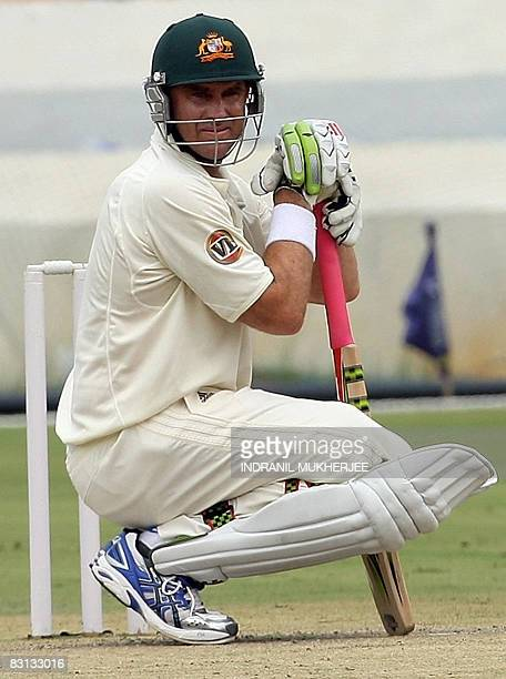 Australian cricketer Mathew Hayden concentrates before the start of their first innings against Indian Board President's XI during the second day of...