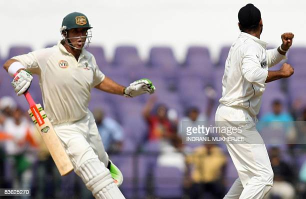 Australian cricketer Mathew Hayden reacts as Indian cricketer Harbhajan Singh celebrates his wicket on the fifth and final day of the fourth and...