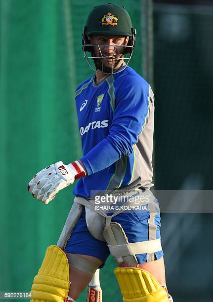 Australian cricketer Mathew Wade walks with his batting equipment during a practice session at the R Premadasa Cricket Stadium in Colombo on August...