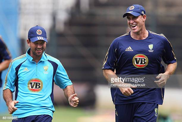 Australian cricketer Matthew Hayden shares a light moment with team captain Ricky Ponting during a practice session at The Chinnaswamy Stadium in...