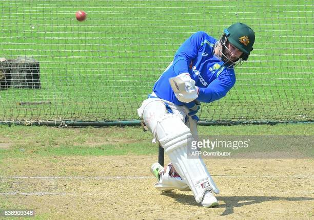 Australian cricketer Matthew Wade plays a shot during a training session at the ShereBangla National Cricket Stadium in Dhaka on August 22 2017...