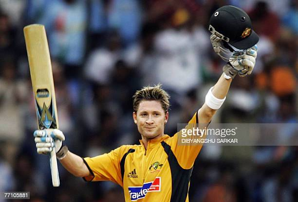 Australian cricketer Michael Clarke celebrates his century during the first One Day International cricket match against India at the Chinnaswamy...