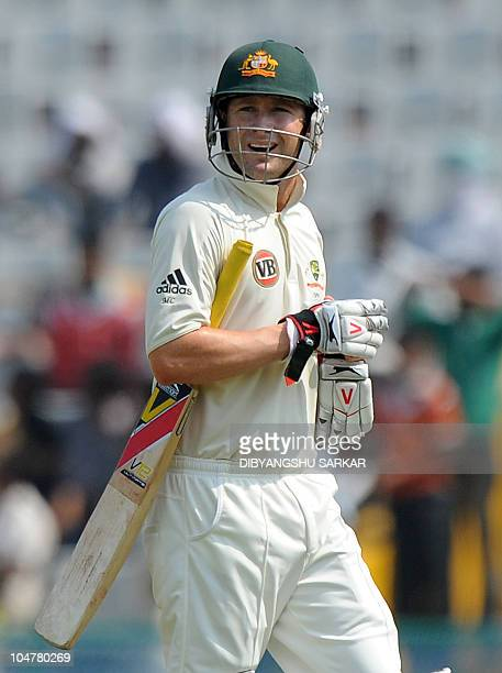 Australian cricketer Michael Clarke walks back to the dressing room after losing his wicket during the fourth day of the first Test between India and...