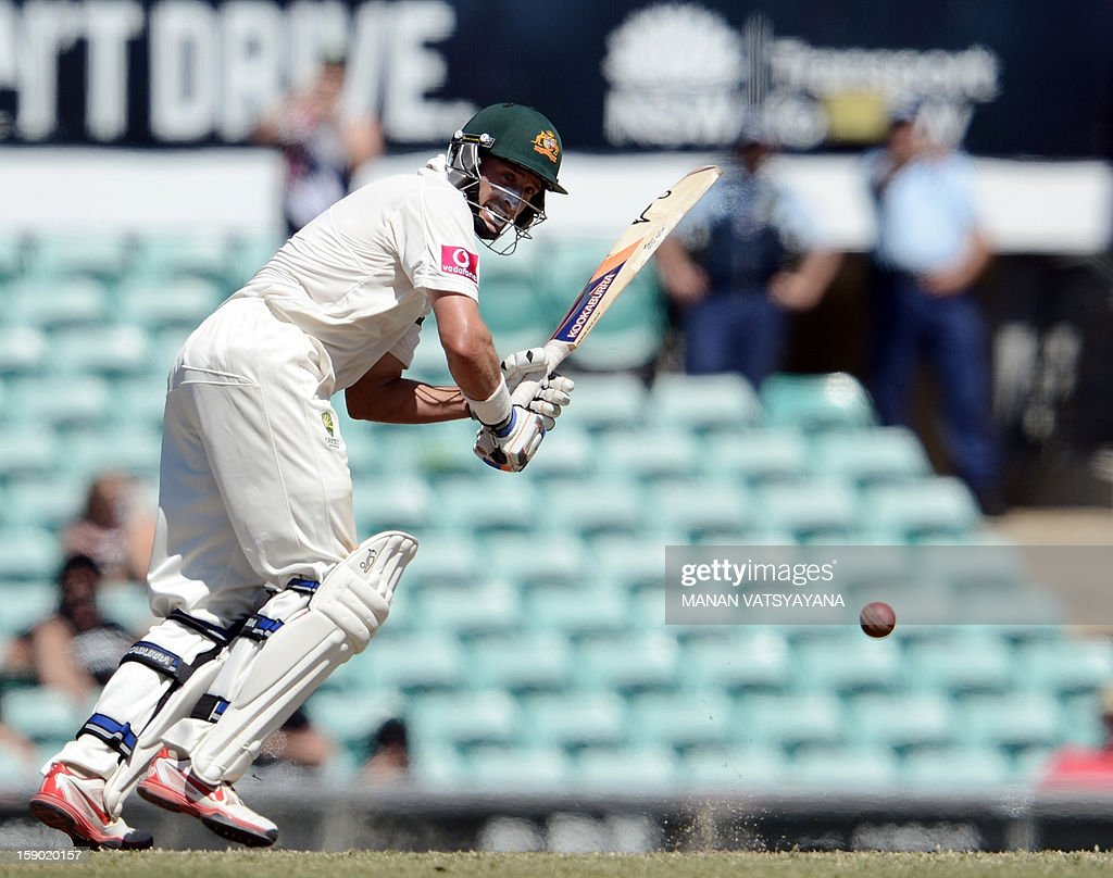 Australian cricketer Michael Hussey plays a shot on the fourth day of the third cricket Test match between Australia and Sri Lanka at the Sydney Cricket Ground on January 6, 2013. Australia beat Sri Lanka in the three Test series 3-0. AFP PHOTO/ MANAN VATSYAYANA USE