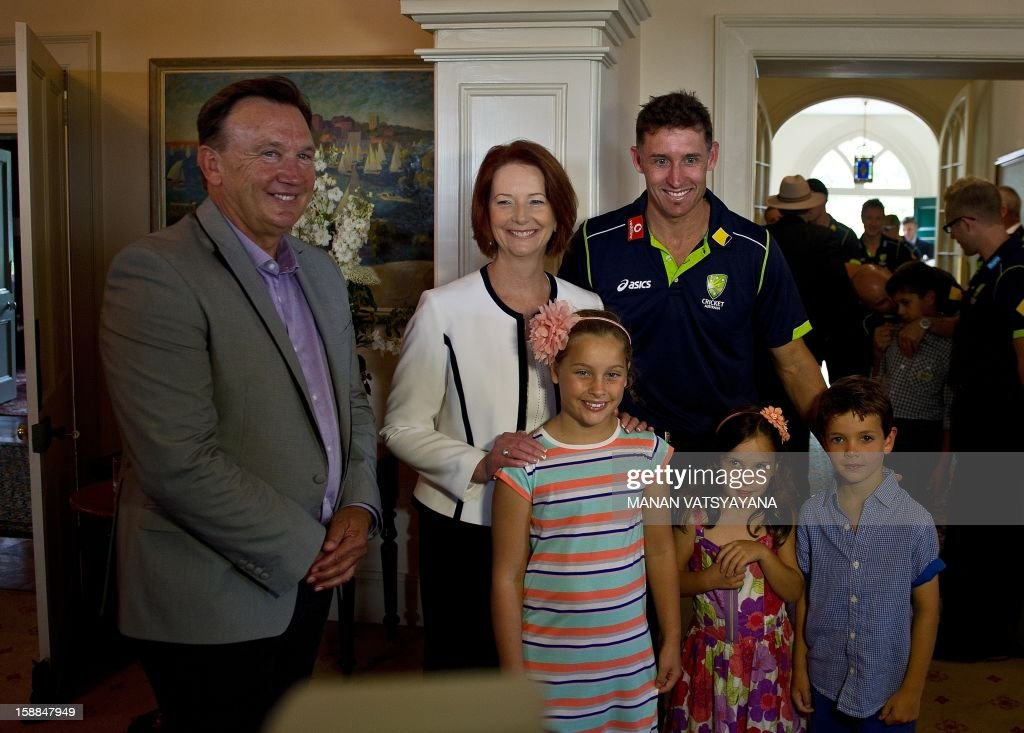 Australian cricketer Michael Hussey (R) poses with his children Molly, Jasmin and William with Australian Prime minister Julia Gillard (C) and her partner Tim Mathierson (L) during an afternoon tea at Kirribilli House in Sydney on January 1, 2013. Australia plays Sri Lanka in the third cricket Test starting at the Sydney Cricket Ground (SCG) on January 3.