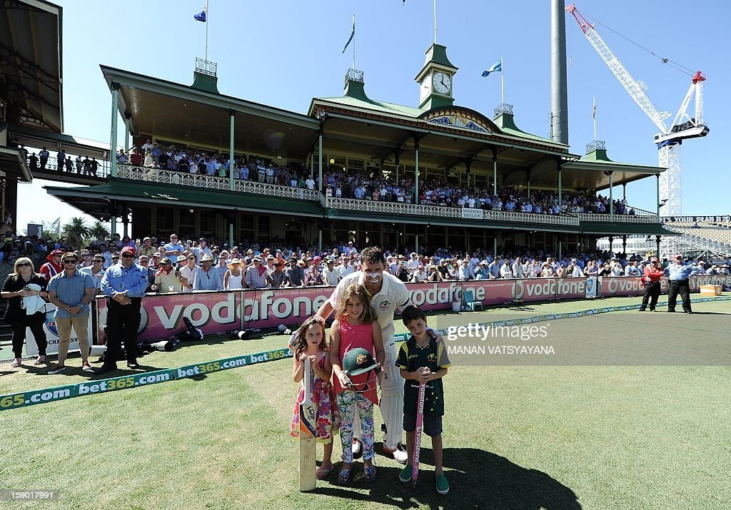Australian cricketer Michael Hussey poses with his children Molly, Jasmin and William after defeating Sri Lanka on the fourth day of the third cricket Test match between Australia and Sri Lanka at the Sydney Cricket Ground on January 6, 2013. Australia beat Sri Lanka in the three Test series 3-0.