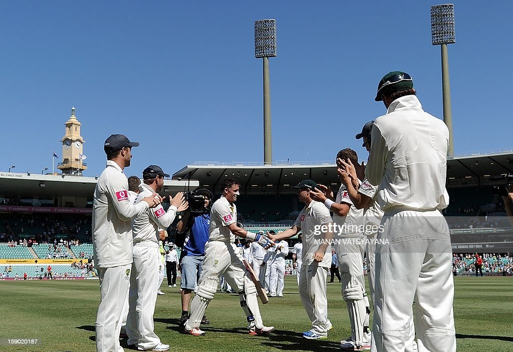 Australian cricketer Michael Hussey (C) shakes hands with teammates as he walks off the field after defeating Sri Lanka on the fourth day of the third cricket Test match between Australia and Sri Lanka at the Sydney Cricket Ground on January 6, 2013. Australia beat Sri Lanka in the three Test series 3-0.