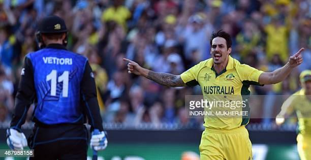 Australian cricketer Mitchell Johnson celebrates the wicket of New Zealand batsman Daniel Vettori during the 2015 Cricket World Cup final between...